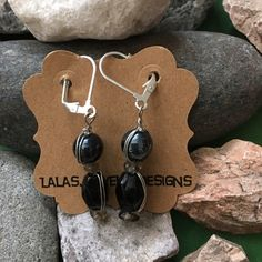 Hematite and Silver Earrings Wrapped in silver hematite and a black bead wrapped with silver wire all on a leaver back earrings. Really nice.. LalasjewelryDesigns Jewelry Earrings
