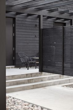 Black paint on wood slats & Concrete
