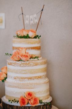 Naked Three-Tiered Vanilla Bean Cake With Peach Roses | Ruth Marie Photography https://www.theknot.com/marketplace/ruth-marie-photography-indio-ca-869267