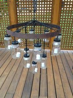 BUT WITH A WHEEL NOT RING Recycle materials - whiskey barrel ring and mason jar = rustic chandelier perfect for barn venue! Chandelier, Wine Barrel Rings, Decor, Mason Jar Lighting, Barrels Diy, Jar Chandelier, Rustic Chandelier, Rustic Diy Projects, Diy Wine