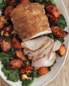 Pork with Persimmons and Mustard Greens  ---  Persimmons add sweetness and a splash of autumn color to roast pork.