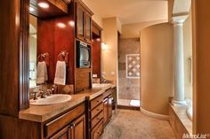 Traditional Master Bathroom with Stone Tile, Wall sconce, Master bathroom, Antique Catania Travertine Tile, High ceiling. Via Zillow the Housing Market Zestimate's.