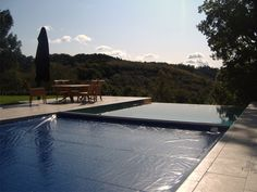 Our Hydramatic Pool Cover on an vanishing edge pool. See more at aquamatic.com!