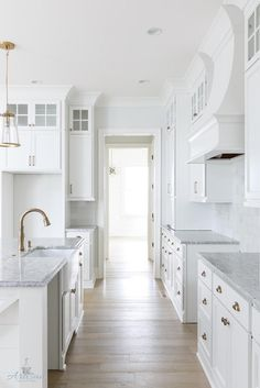 "Open Kitchen Design that could work in our house - cabinets painted Benjamin Moore OC-64 Pure White, 2 ""appliance garage"" cabinets, shiplap paneling under island, honed marble backsplash with brass schluter strips, Salinas granite countertop, pendant lights from Crate and Barrel"