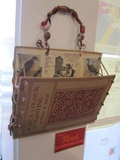 I really like this repurposed book mail holder. I don't think it would be that difficult to make but this pic is from a work by Nina Rossi $22 — at LOOT found + made