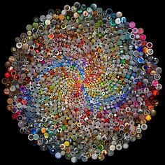 This mosaic was made from 1099 individual photographs of circles, photographed by 265 talented individuals. It was constructed algorithmically by Jim Bumgardner The photographs are arranged in a fibonacci spiral. If you count the number of spirals in each direction, the result will be two successive numbers in the fibonacci series. Enlarge to view