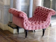 This pink upholstered very unique curved stool / bench would look incredible in our salon at Far Out Inn <3