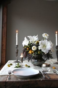 elegant yet rustic floral arrangements - I'm so in love!  I would change out to silver or white bowl and candlestick holders instead of the pottery look here.