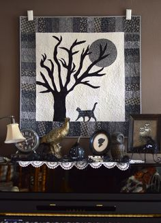 All Hallow's Eve Wall Quilt ~ spooky cat & tree silhouette all in greys for Halloween! clean design & simple piano key border ~ shown ft Penny Rose fabrics   free sewing tutorial from Jedi Craft Girl