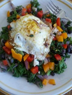 Endo diet breakfast.  Delish!  Kale, onions, blackbeans, garlic, peppers with an egg on top.