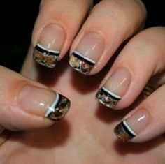 Camo nails. I kinda want these but on the pointer fingure antlers....