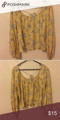 Forever 21 blouse Yellow with white and black leaves. Cute tie in back and on sleeves. Might be a little crop top-y on a taller person Forever 21 Tops Blouses