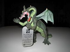 Travel Bugs come in all shapes and sizes - the tag is actually the travel bug, but it is generally attached to another object.  In this case - a dragon.