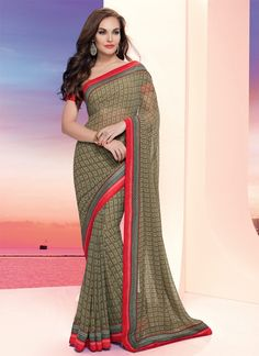 You will be bound to make a powerful style statement with this beige georgette casual saree. The ethnic print work within the dress adds a sign of beauty statement with a look. Comes with matching blo...