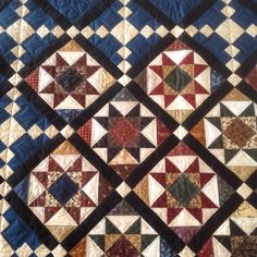 Close up of blue and black civi war star quilt top. Love using up the scrap bag!