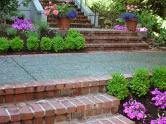 The brick steps tie in with the brick porch, and the colorful plants create a private yet inviting front garden.