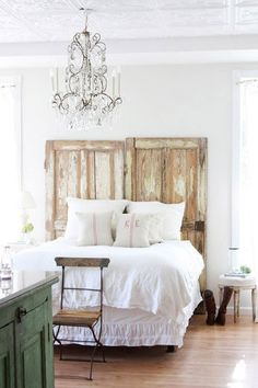 I love the distressed doors but I wish they were different somehow. Connected evenly, or maybe wall-mounted. Adore the chandelier!