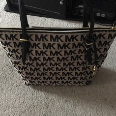 Michael kors jetset blk tote nwt Beautiful big Michael kors bag. Black mk pattern with black straps and gold hardware. Very roomy with inside compartments. New wit tags Michael Kors Bags Shoulder Bags