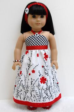 Red and black floral halter dress by TwirlyDollDesign on Etsy. Made from the Simply Summer Sundress pattern. Get it at http://www.pixiefaire.com/products/simply-summer-sundress-18-doll-clothes. #pixiefaire #simplysummersundress
