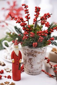 Cute Santa with pot & berries