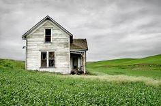 Abandoned farmhouse in wheat field, Palouse Country, Eastern Washington.