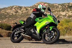 Green Colored Kawasaki Ninja riding through the mountains Kawasaki Er6f, Kawasaki Ninja, Pebble Beach Car Show, Mario Andretti, Kawasaki Motorcycles, Mans World, Bike Life, Sport Bikes, Ducati