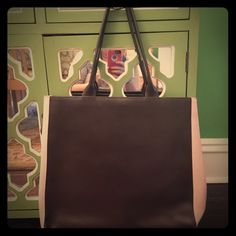 Furla brown and pink leather tote Authentic Furla tote bag in chocolate brown and pink leather. Huge size is perfect for work or school, measures 15 by 17. Snap top. Signature brown Furla lining. Purchased on posh and barely used. Excellent condition with no flaws. Furla Bags Totes