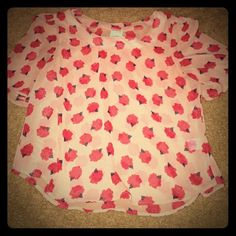 Happening in the Present Blouse Rose Print Happening in the Present (H.I.P.) blouse. Size M. Tan with a red rose pattern. Length is 25 inches. Would be great with a high waisted skirt. 100% polyester. From Nordstroms. No flaws or stains. Happening in the Present  Tops Blouses