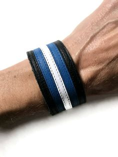 BDSM leather pride cuff, leather fetish, pride leather, mens leather cuff, black, blue, and white. by threedollarbillshop on Etsy