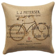Vintage pillow with Bicycle - this is a winner because it is vintage in style, it has an old bike on it, and the fabric looks like burlap.