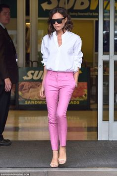 Victoria Beckham rocks two smart looks in chic shirts and trousers as she jets…