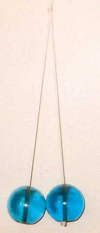 Ouch!  The original Clackers -  this was a fun but, painful toy to learn how to use...lol.