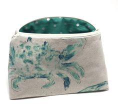 A personal favorite from my Etsy shop https://www.etsy.com/listing/464744651/watercolor-crabs-cosmetic-bag-nautical