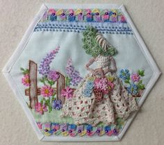 Crinoline Lady Hexie by Kay Lea. The crocheted lady was embellished and added to an embellished and shaded old vintage small embroidery piece.