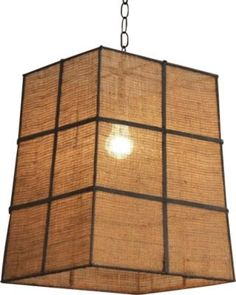 Burlap shade with metal grid dividing the structure into six squares on each side, wider at the bottom. Would be a cool out door light!