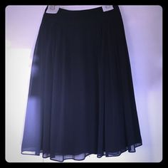 Navy WHBM Soft Pleated Skirt - NWT Beautiful navy chiffon skirt from White House Black Market. Below-the-knee length, back zipper closure. NWT. Has been out of stock on WHBM website for quite a while now. White House Black Market Skirts