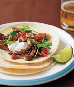 Slow Cooker Pulled Pork Tacos-I use boneless pork ribs b/c it's easier to find than a roast. (Via Real Simple)