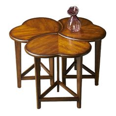Set of three rubberwood nesting tables with jigsaw-style tops.Product: Set of 3 nesting tablesConstruction Material: ...