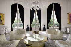 white walls with DRAMATIC black curtains. don't mind if i do!