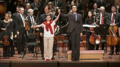 Will Moffat and Ken-David Masur take a bow after our Everyday Heroes concert.