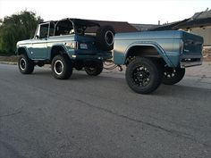 jumbo green vintage lifted ford bronco small Ford SUV hauling a matching Bronco trailer