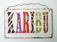 *Karibu - Willkommen*    Karibu ist Suaheli und heisst Willkommen.  Dieses Türschild gehört natürlich an jedes afrikanische Haus.         Zum Aufhä...