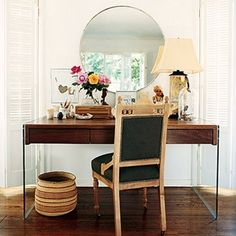 Love the big desk, mirror and flowers