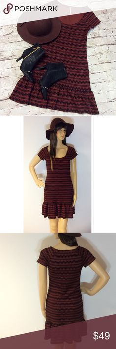 """FREE PEOPLE SWEATER DRESS This is soooo darn cute. It's made of a sweater like material with a scoop neckline and cap sleeves, topped off with a ruffle hem. Color is rust and black and it's fully lined. Measurements lying flat Armpit to armpit 15"""" length 32"""" Free People Dresses Mini"""