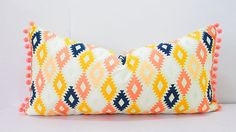 Spruce up your living room or bedroom with this cute pink and orange bohemian pillow cover! Made from designer fabric in pink, orange, navy blue