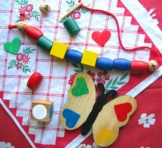 wood caterpillar and butterfly toys