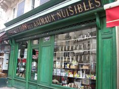 Julien Aurouze and Co. - Parisian pest control shop with a window display of dead rats