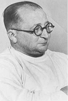 Nazi physician Carl Clauberg,  who performed medical experiments on prisoners in Block 10 of the Auschwitz camp. Place and date uncertain.