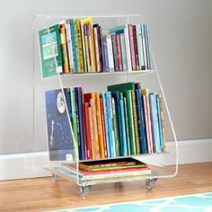 For our next trick, we're going to make your bookshelf disappear. Well, not really, but we will allow you to replace it with this modern, seamless bookcart. The clear, acrylic construction makes your books appear as if they're floating. Plus, the rolling casters make it easy to move from one corner of the room to the other.