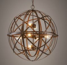 RH baby&child's Orbital Sphere Large Pendant Rust:Evoking an industrial-era character with its riveted fabrication and rustic finish, our pendant is formed entirely of concentric metal bands.